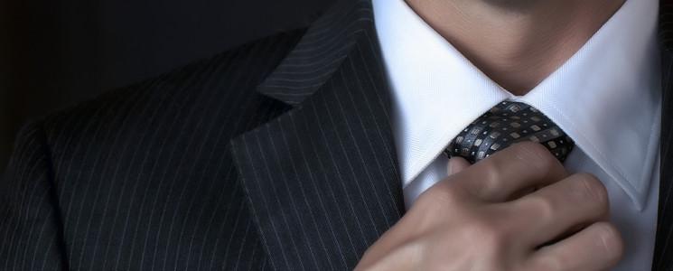 Man-Adjusting-Tie-sm
